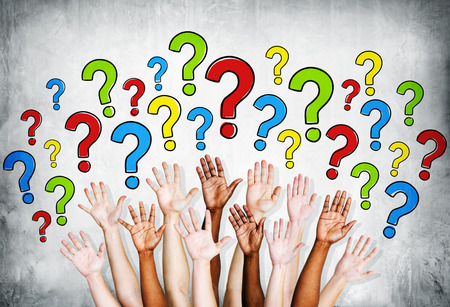question marks: Multi-ethinic arms outstretched to ask questions. Stock Photo