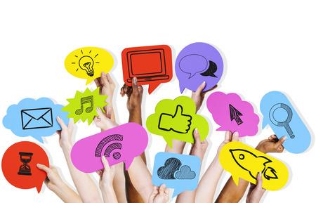 Hands holding social media icons. 免版税图像