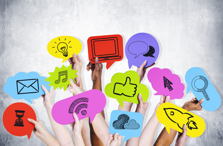 social networking: Hands holding social media icons. Stock Photo