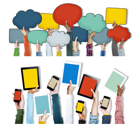 Group of Hands Holding Digital Devices and Speech Bubbles