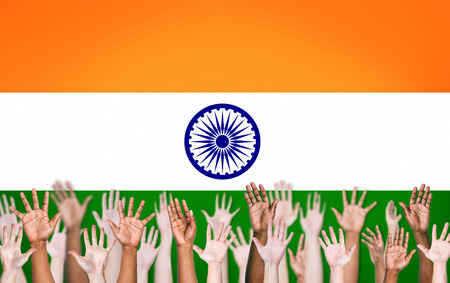 indian flag: Group of Multi-Ethnic Peoples Hands Raised Up on an Indian Flag Background