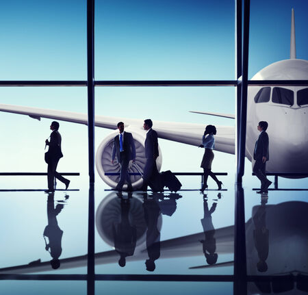 flight mode: Silhouettes of Business People in the Airport