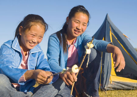 independent mongolia: Mongolian Two siters anjoy camping.