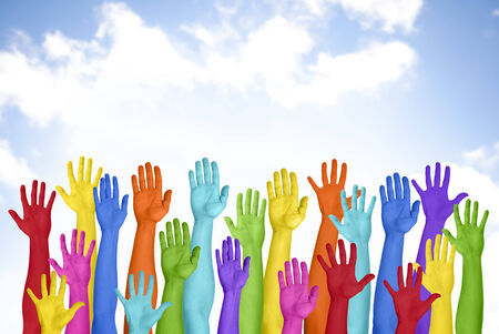 Colorful Hands Raised With Blue Sky photo
