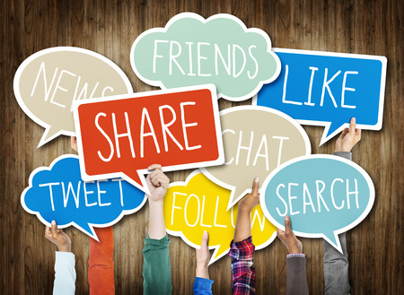multi media: Hands Holding Speech Bubbles with Social Media Words Stock Photo