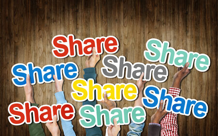 social issue: Group of Hands Holding the Word Share