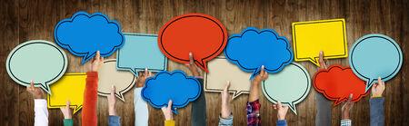 Group of Hands Holding Speech Bubbles Banco de Imagens