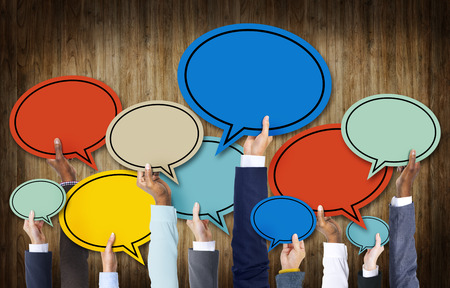 african business: Group of Hands Holding Speech Bubbles Stock Photo