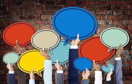 bubble people: Diverse Hands Holding Colorful Speech Bubbles