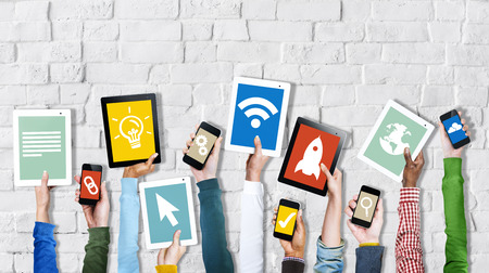 Group of Hands Holding Digital Devices with Startup Concept photo