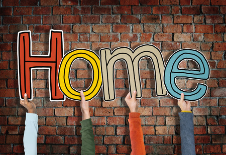 diversity domain: Hands Holding Word Home Concept Stock Photo
