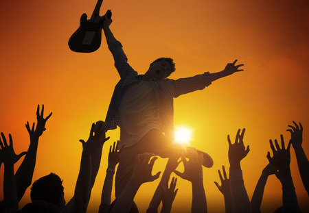 Silhouette of a Young Man Performing in Front of the Crowd photo