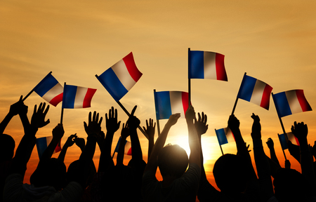 Silhouettes of People Holding the Flag of France photo