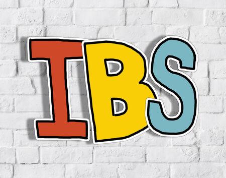 constipated: IBS Carta sobre la pared de ladrillo en la Vuelta
