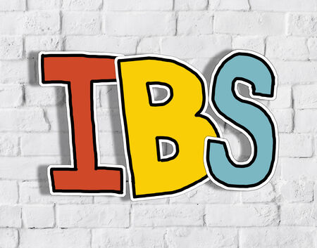 bowel disorder: IBS Letter on Brick Wall in the Back