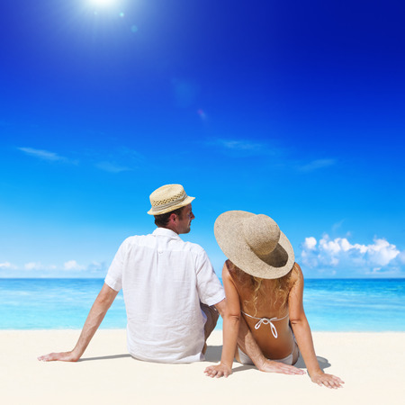 Couple relaxing on the beach. photo