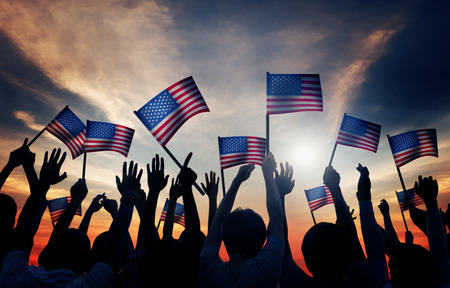 patriotic: Group of People Waving Armenian Flags in Back Lit Stock Photo