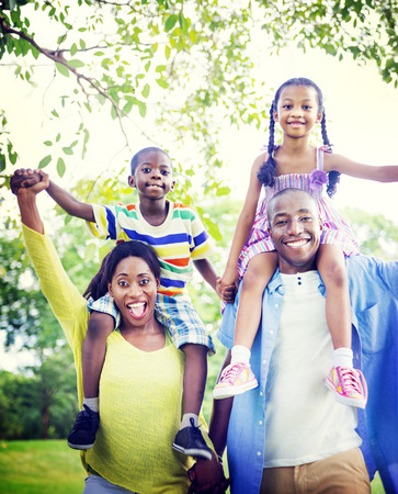 family fun: Family Bonding Happiness Togetherness Park Concept Stock Photo