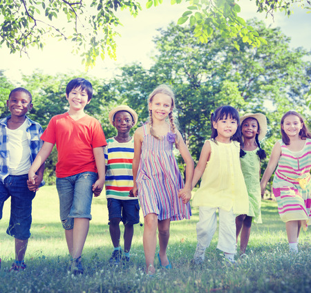 positive positivity: Diverse Children Friendship Playing Outdoors Concept Stock Photo