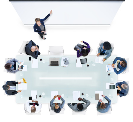 computer speaker: Business People Having a Meeting in the Office Stock Photo
