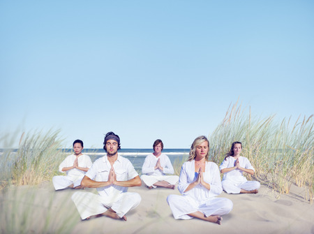 eyesclosed: Group of People Doing Yoga on Beach