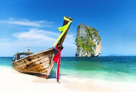 Paradise Island with a Longtail boat. Poda Island, Krabi, Thailand.