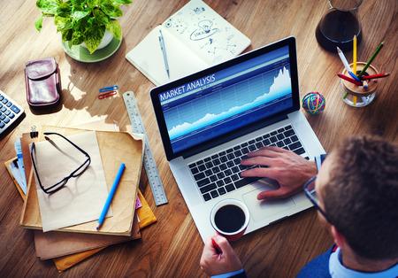 business marketing: Man Analysis the Market on Computer