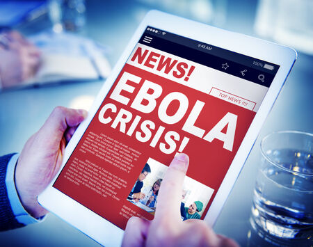 current events: Businessman Holding Tablet Ebola News Concept