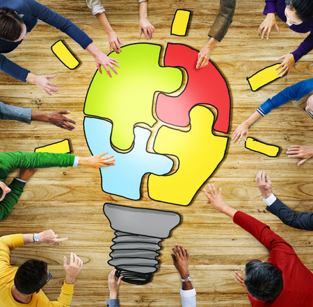 bulb light: Diverse People with Teamwork and Innovation Concepts Stock Photo