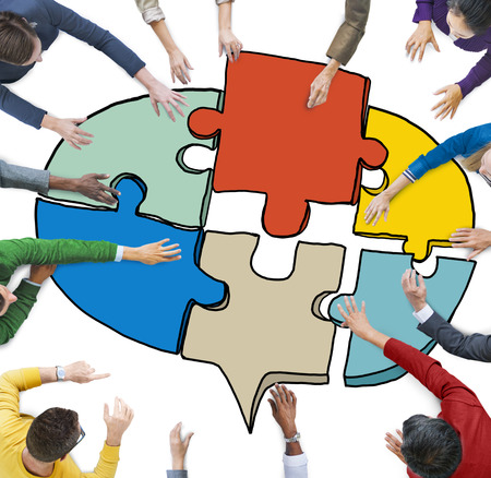 creating: Business People Forming a Jigsaw Puzzle Speech Bubble Stock Photo