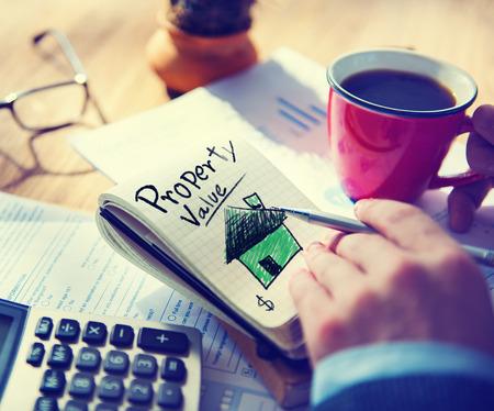 Businessman Notepad Property Value Concept Standard-Bild