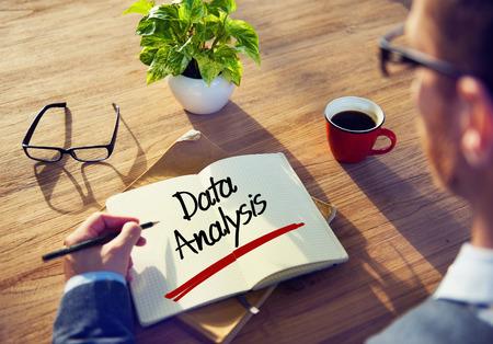 Businessman Writing the Word Data Analysis photo