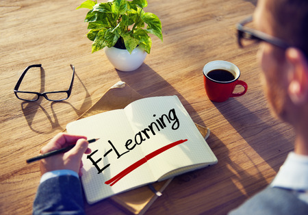 elearning: Businessman Writing the Word E-Learning