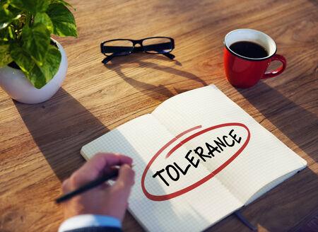 tolerance: Businessman Writing the Word Tolerance