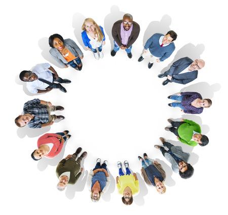 見上げて、円を形成多民族の人々 のグループ 写真素材