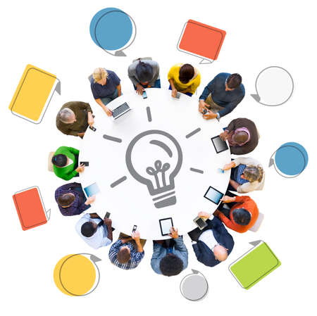 idea generation: Multiethnic Group of People Using Digital Devices with Idea Generation Stock Photo