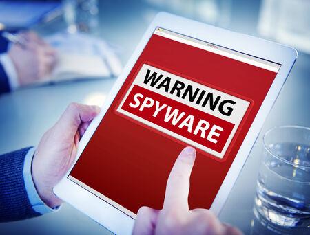 spyware: Hands Holding Digital Tablet Spyware