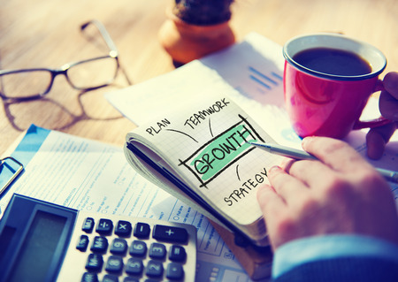 Businessman Writing Growth Strategy Concept photo