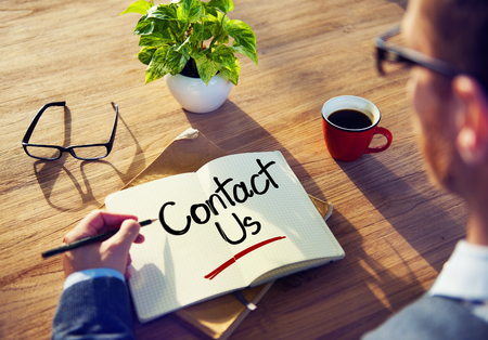 Man with a Note and Contact Us Concept