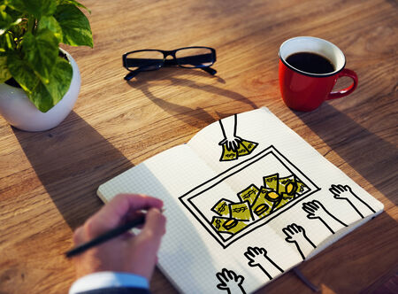 drawing pad: Businessman Drawing Finance Concept on a Note Pad Stock Photo