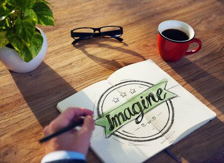 to imagine: Businessman Writing the Word Imagine