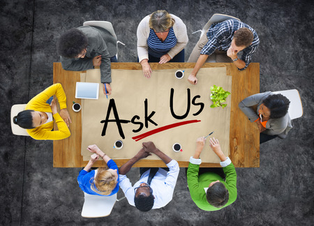 of inquiry: Group of Business People Discussing About Inquiry Stock Photo