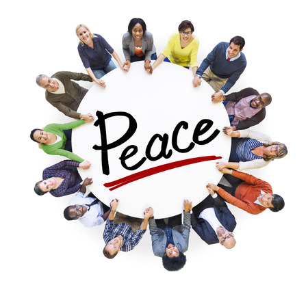Group of People Holding Hands Around Letter Peace photo