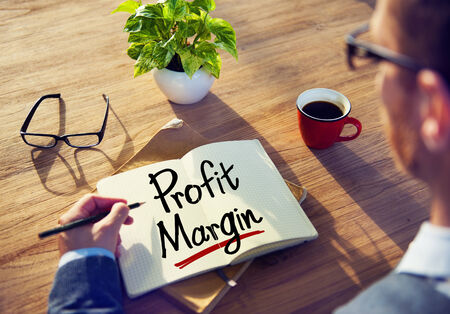 Man with a Note and a Word Profit Margin photo