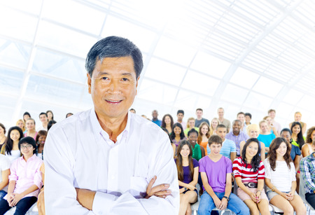 Teacher and large group of student in Lecture room photo
