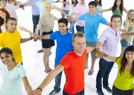 Large group of young multi-ethnic people connecting with each other