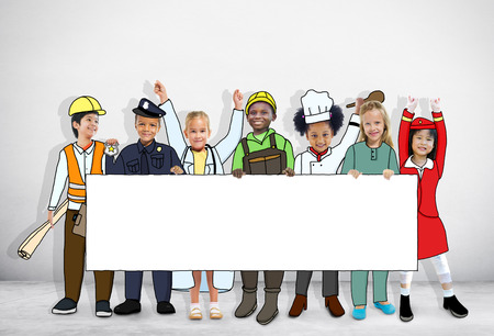 Group of Children in Dreams Job Uniform Holding Banner with Copy Space photo