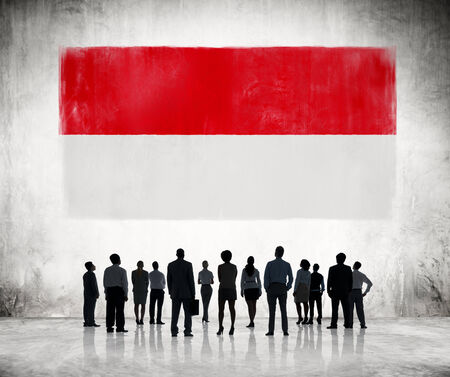 the indonesian flag: Silhouettes of Business People Looking at the Indonesian Flag