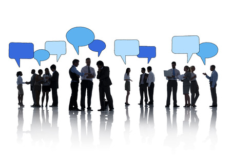 Silhouettes of Business People Working and Speech Bubbles photo