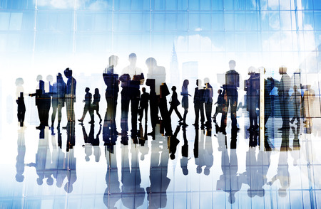 large group of people: Silhouettes of Business People Working in an Office Stock Photo